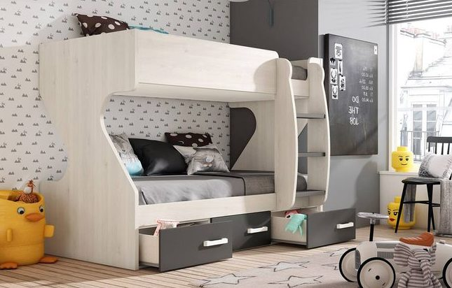 un nico mueble compacto con dos camas y escritorio con cajonera el espacio debajo de las camas se aprovecha para almacenaje